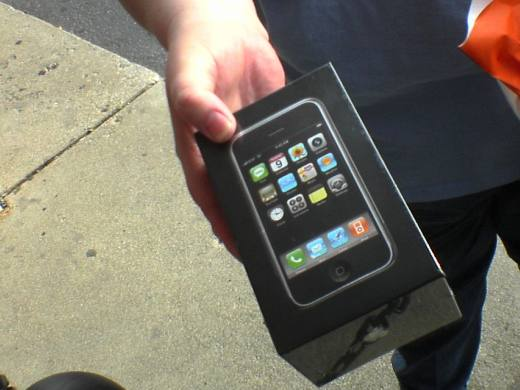 person holding purchased iphone