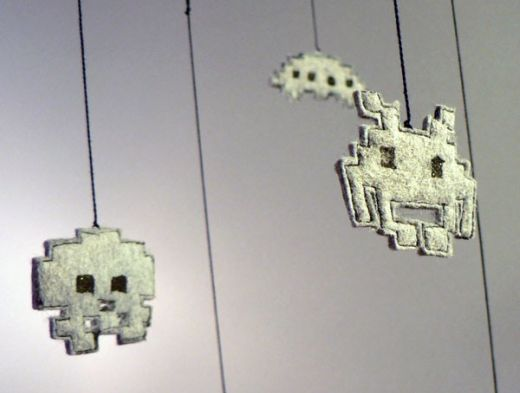 Space Invaders Mobile Hovers Over Head