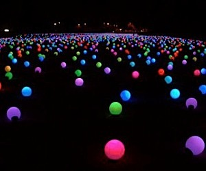 10,000 LED Orbs Land in a Field in Italy
