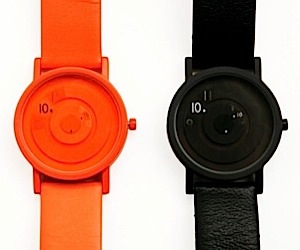 Reveal Watches Tell Time a Little Bit at a Time