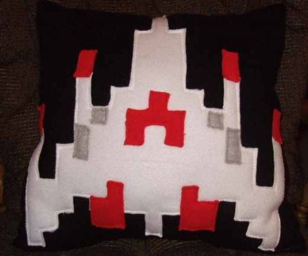 Cuddle Up With This Fleece Galaga Fighter Pillow