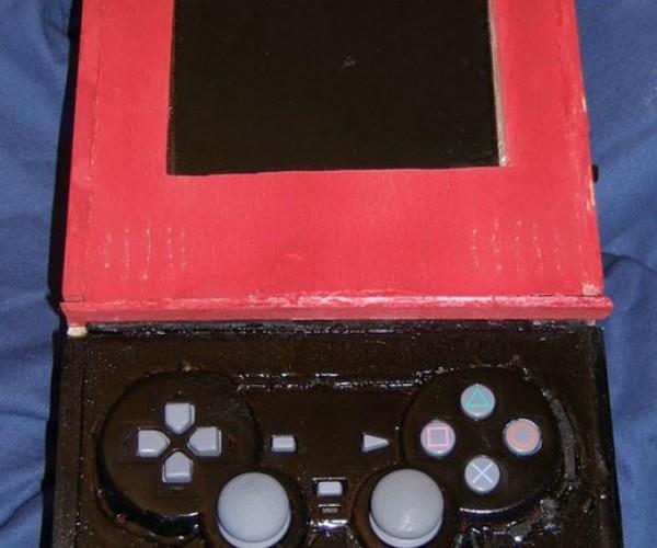 Original Playstation Shoved Into a Wooden Box