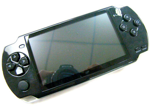 Pxp 900 retro 8 16 32 bit handheld video game system looks an awful lot like a psp technabob - Retro game emulator console ...
