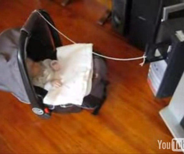 Dad Finds New Use for CD-ROM Tray: Baby Rocker