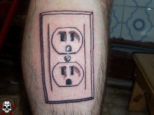 All he needs is a tattoo power cord and he's good to go. geeky-tattoo-outlet