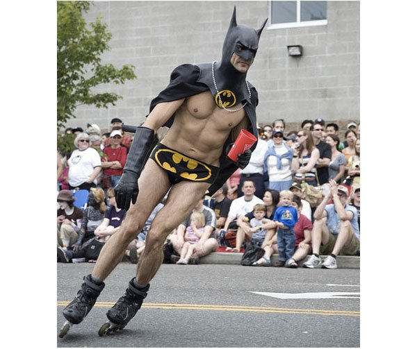 half naked batman rollerblading