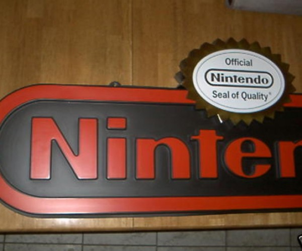 Nintendo Ces Display Sign: Stamped With Gold Seal of Quality