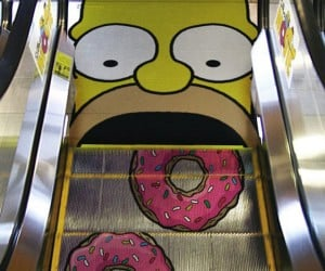 Homer Eats Some Donuts on the Escalator
