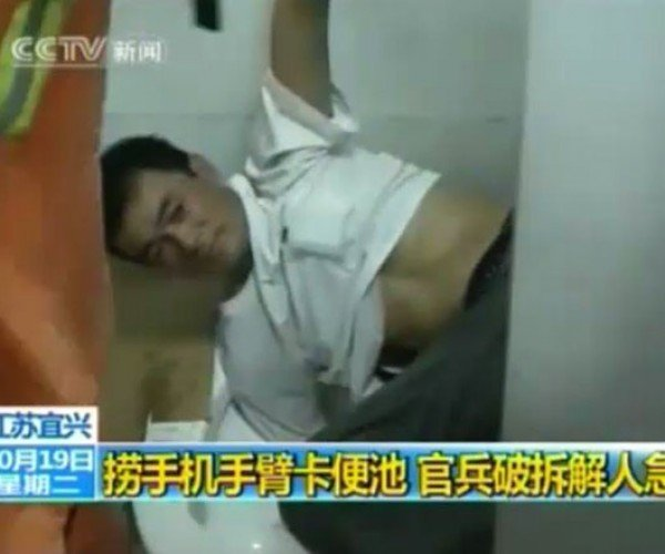 Dude Gets Stuck in Toilet Trying to Save Mobile Phone