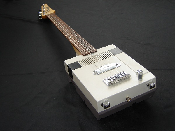 old nes gets a new life as an electric guitar. Black Bedroom Furniture Sets. Home Design Ideas