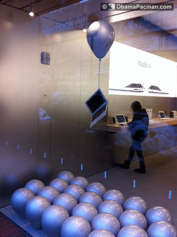 macbook air tied to balloon