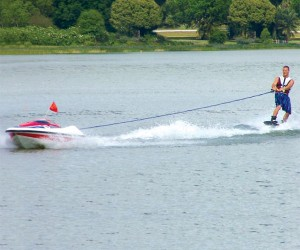 Water-Skier Controlled Tow Boat for Solo Show-Offs
