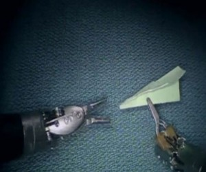 Surgeon Uses Robotic Tools to Make Tiny Paper Airplane