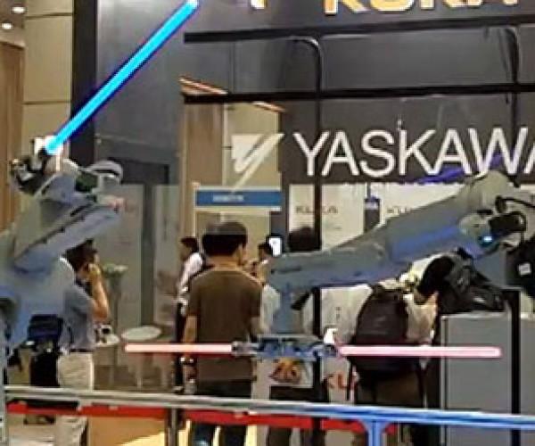 Yaskawa Industrial Robots Have a Lightsaber Duel