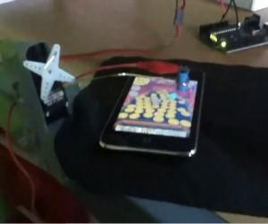Guy Builds Robot Arm to Play Coin Dozer: Gold Farmer