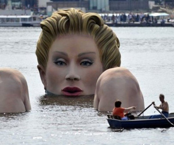 Giant Lady Sighted Bathing in Hamburg's Alster Lake