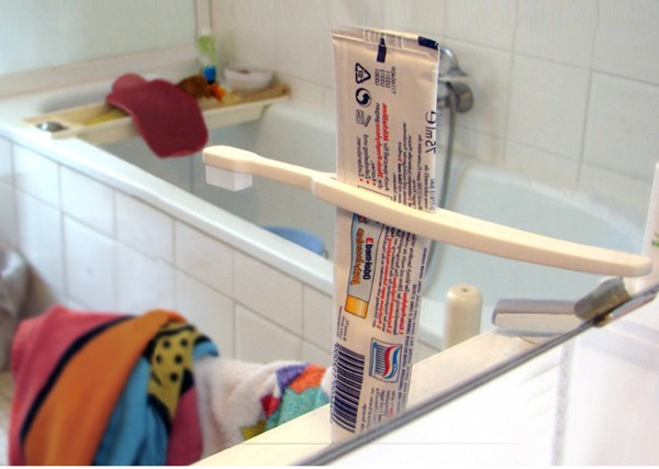 Tube Squeezing Toothbrush