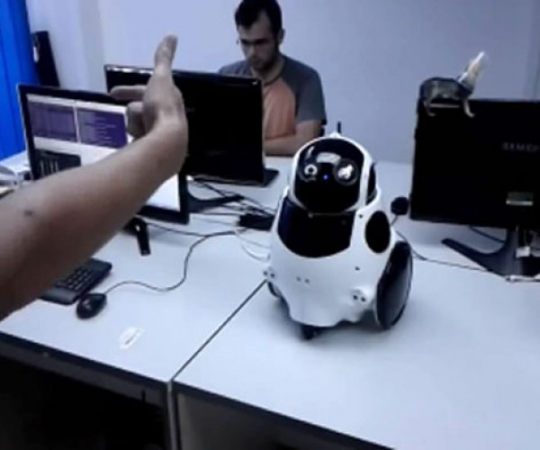 Qbo Robot as Gesture Controlled Music Player