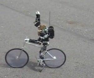 Primer-V2 Robot Rides a Bike, No Training Wheels Needed