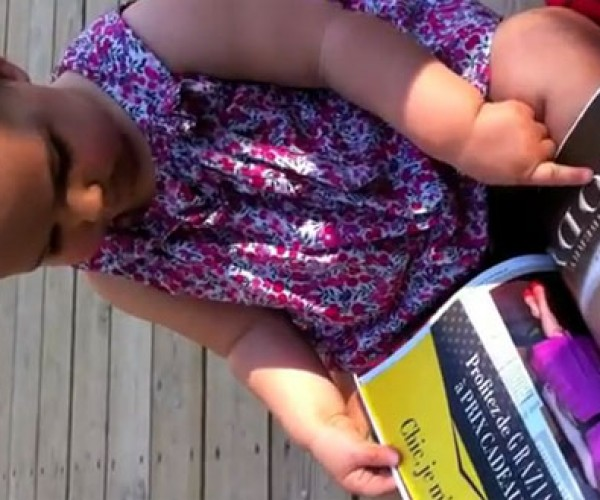Adorable Baby Tries to Use Magazine Like an iPad