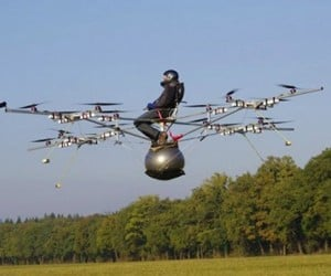How Many Tiny Helicopters Does It Take to Lift a Human? 16, if the Human Goes Willingly