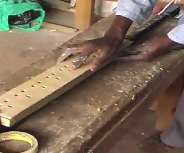 African Entrerpreneur Making Wooden Outlet Strips