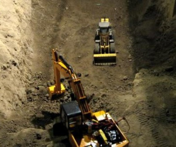 Guy Digs Up Basement Using R/C Scaled Models, Must Not Be Married