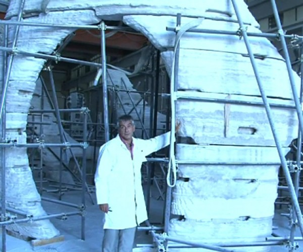 Man Working on 3D Printed House: Downloadable Dwelling