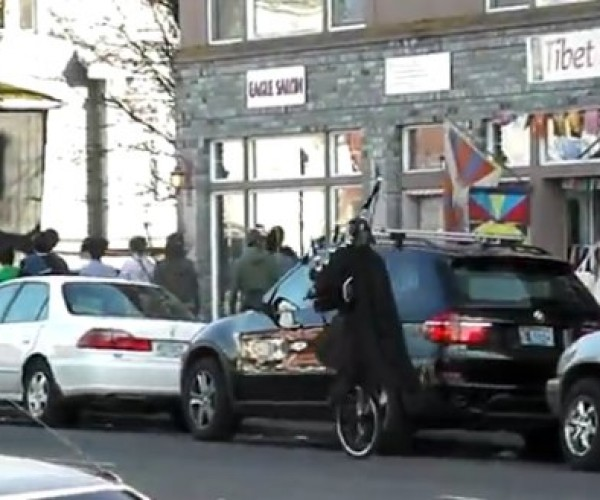 Darth Vader Riding a Unicycle, in a Kilt, Playing Bagpipes