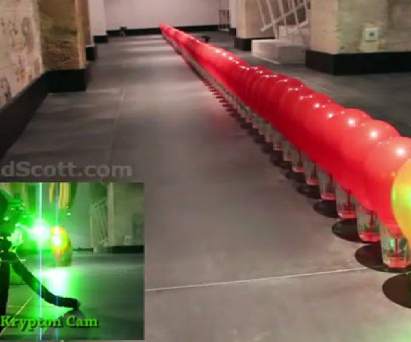 Popping 100 Balloons with a Laser Pointer Is Just as Cool as It Sounds