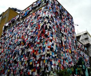 Campaign to Recycle Fashion Covers Buildings with Used Clothing
