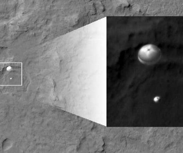NASA Unveils Photo of Curiosity Parachuting Towards Mars