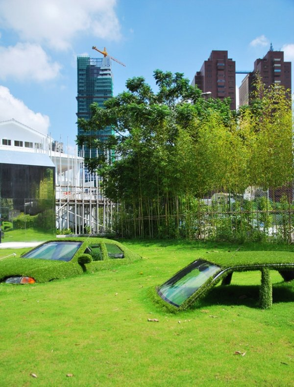 Cars Swallowed by Grass