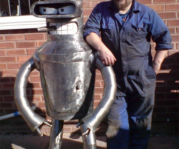 Bender Wood Stove Ready to Smoke Some Meat in His Shiny Metal Carcass