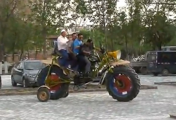 Chinese Worker Builds Giant Motorcycle So Big It Needs Training Wheels