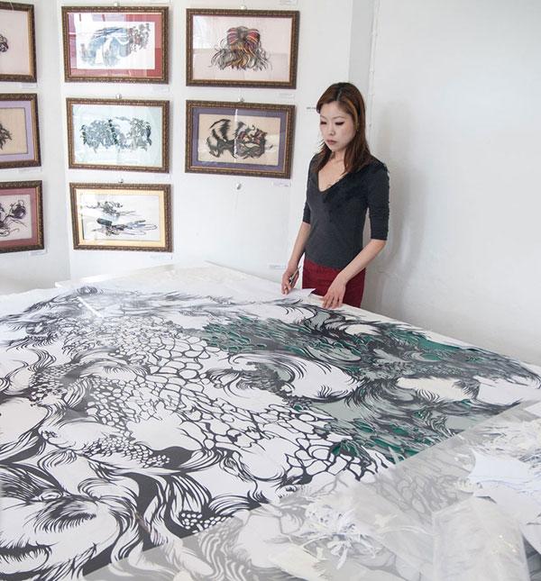 paper cut art nahoko kojima cloud leopard artist photo