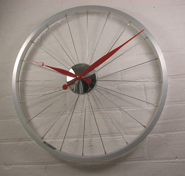bike wheel clock red white wall