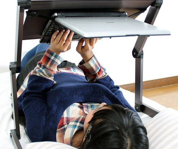 Lie-Down Laptop Stand Lets You Work Like an Astronaut in Bed
