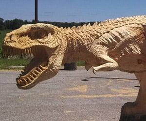 Chainsaw Carved Dinosaur: Prehistoric Pine