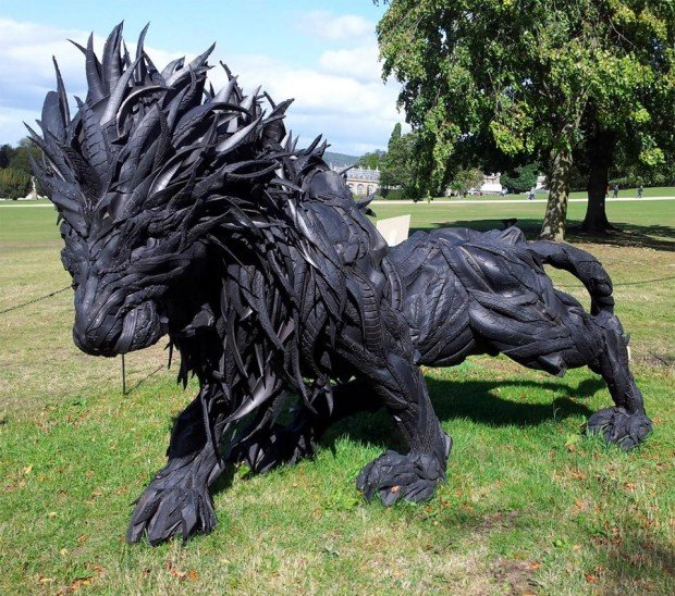 This lion sculpture is made out of tires i said tire iron for What can you make out of old tires