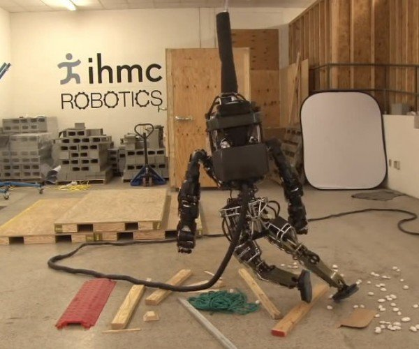 Atlas Humanoid Robot Attempts to Walk on Rubble, Struggles