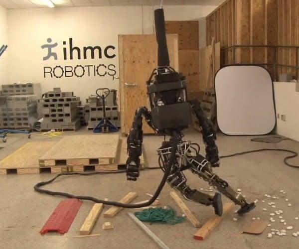 Atlas Humanoid Robot Attempts to Walk on Rubble, Struggles