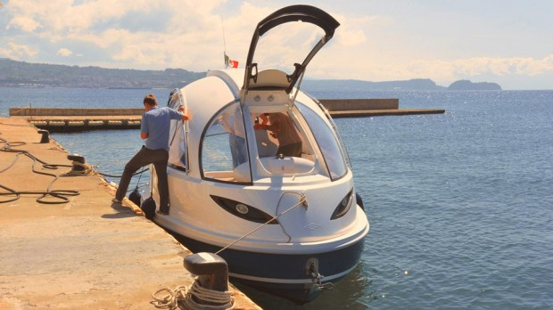 jet capsule boat yacht docked photo