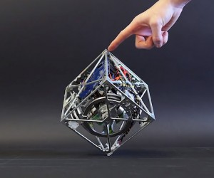 Cubli Robot Cube Balances, Jumps and Walks: A Better Companion Cube