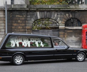 Sherlock Premier Tipped by Flowers in a Hearse