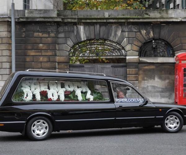 Sherlock Premier Tipped by Flowers in a Hearse