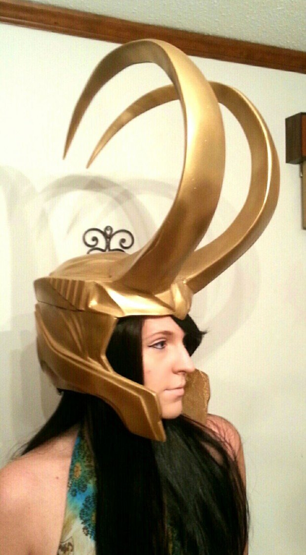 loki helmet replica by raptor with a shotgun 620x1123