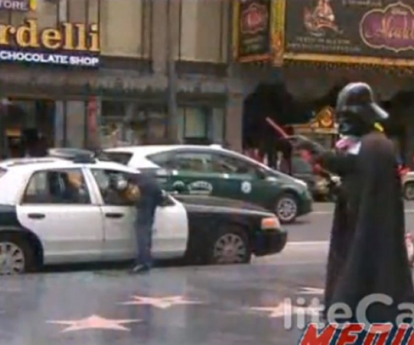 Guy Breaks into LAPD Car in Front of Darth Vader and Superman