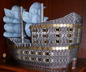 Ship Built out of Coins Sails the Curren Sea