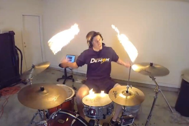 guy drums with fire